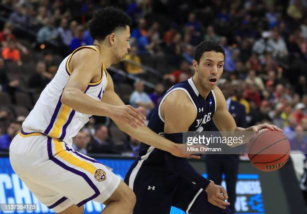 Alex Copeland of the Yale Bulldogs dribbles the ball against Skylar Mays of the LSU Tigers in the first half during the first round of the 2019 NCAA...