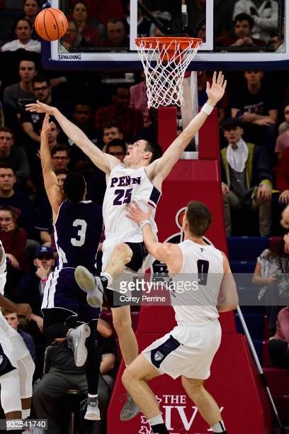 Alex Copeland of the Yale Bulldogs shoots the ball against AJ Brodeur of the Pennsylvania Quakers during the first half of a semifinal round matchup...
