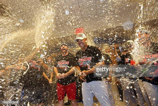 Alex Cora of the Boston Red Sox celebrates in the locker room with his team after defeating the New York Yankees to win Game Four American League...