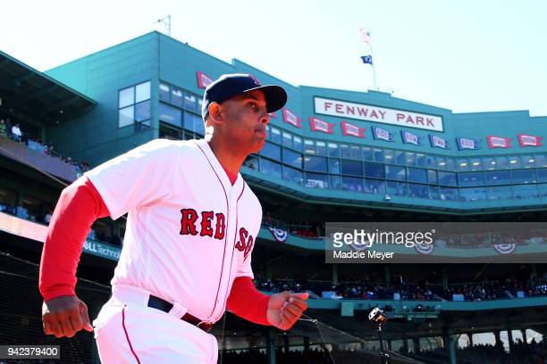 Alex Cora of the Boston Red Sox is announced before the Red Sox home opening game against the Tampa Bay Rays at Fenway Park on April 5 2018 in Boston...