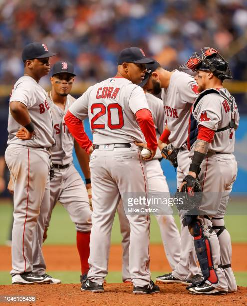 Alex Cora of the Boston Red Sox makes a pitching change during the game between the Boston Red Sox and the Tampa Bay Rays at Tropicana Field on...