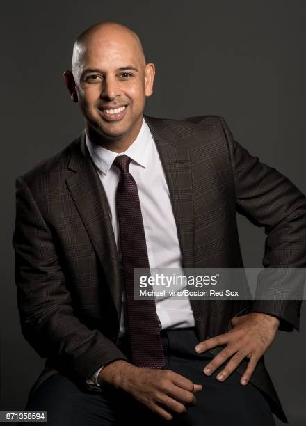 Alex Cora of the Boston Red Sox poses for photographs after being introduced as the newest Manager of the team during a press conference at Fenway...
