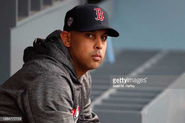 Alex Cora of the Boston Red Sox sits in the dugout prior to Game Five of the 2018 World Series against the Los Angeles Dodgers at Dodger Stadium on...