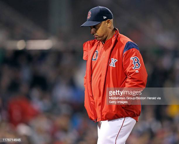 Alex Cora of the Boston Red Sox walks back to the dugout after visiting the mound during the fifth inning of the MLB game against the San Francisco...