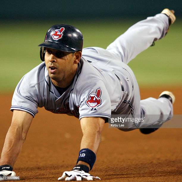Alex Cora of the Cleveland Indians slides into third base in the fifth inning of 54 loss to the Los Angeles Angels of Anaheim at Angel Stadium in...