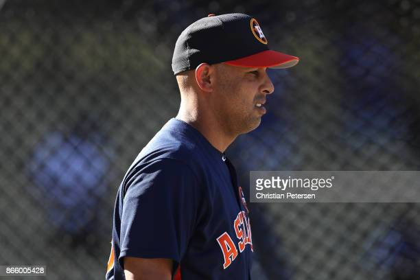 Alex Cora of the Houston Astros looks on during batting practice prior to game one of the 2017 World Series against the Los Angeles Dodgers at Dodger...