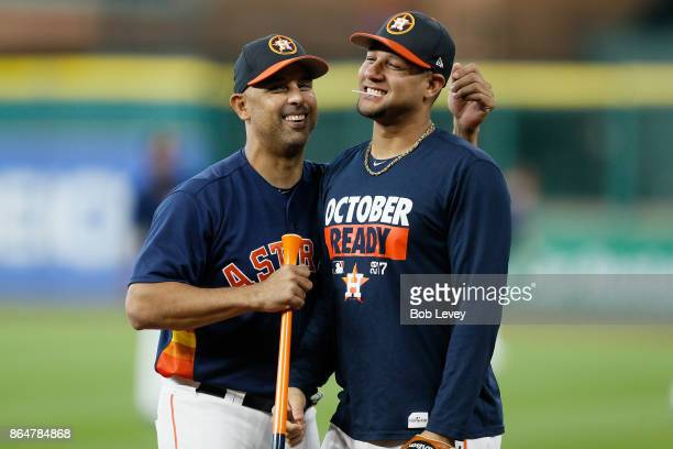 Alex Cora of the Houston Astros talks with Yuli Gurriel during batting practice prior to Game Seven of the American League Championship Series...