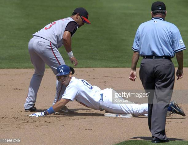Alex Cora of the Los Angeles Dodgers slides into second base beneath tag of D'Angelo Jimenez of the Cincinnati Reds on a fourthinning double during a...