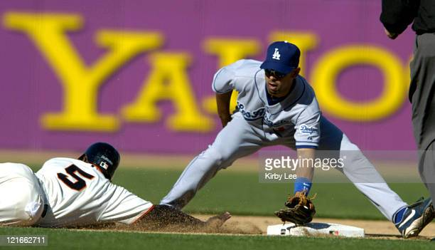 Alex Cora of the Los Angeles Dodgers tags out Ray Durham of the San Francisco Giants on a pickoff at second base in the fifth inning of a 93 loss at...