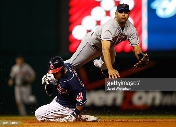 Alex Cora of the New York Mets attempts to turn a double play over Carlos Santana of the Cleveland Indians during the game on June 15 2010 at...
