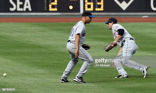 Alex Cora of the New York Mets can't hold onto a ball hit by Jayson Werth of the Philadelphia Phillies as Jeff Francoeur pursues the ball in the...