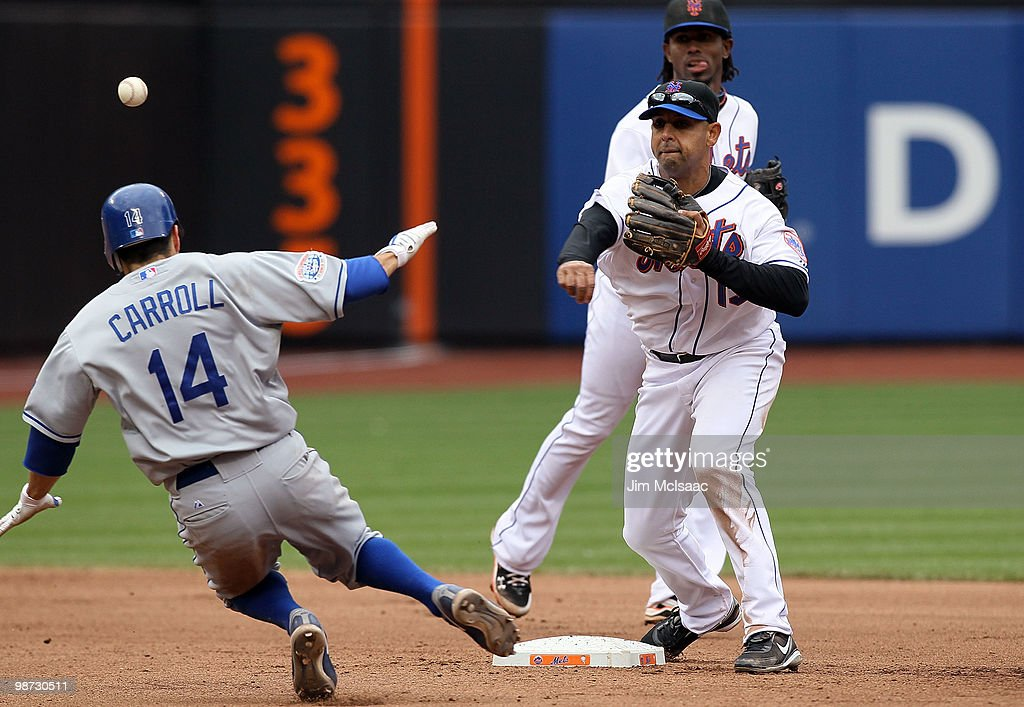 Alex Cora #13 of the New York Mets completes a seventh inning ending double play after forcing out Jamey Carroll #14 of the Los Angeles Dodgers on April 28, 2010 at Citi Field in the Flushing neighborhood of the Queens borough of New York City.