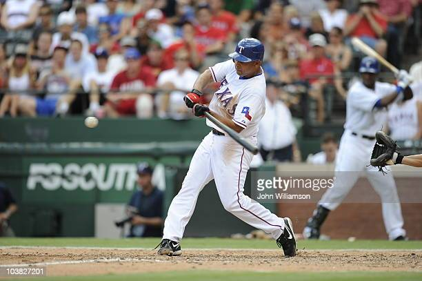 Alex Cora of the Texas Rangers bats during the game against the Oakland Athletics at Rangers Ballpark on August 29 2010 in Arlington Texas The...