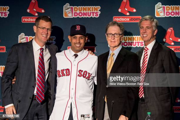 Alex Cora shakes hands with Boston Red Sox President CEO Sam Kennedy Boston Red Sox Principal Owner John Henry and Boston Red Sox President of...