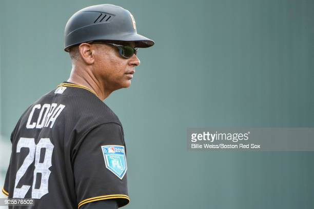Alex Cora third base coach of the Pittsburgh Pirates and brother of manager Alex Cora of the Boston Red Sox looks on during a game at JetBlue Park at...