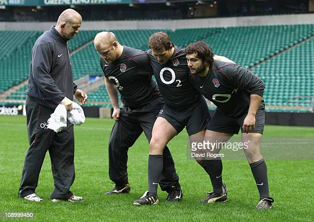 Alex Corbisiero, who will replace the injured Andrew Sheridan in the front row receives instructions from front row coach Graham Rowntree with Dylan...