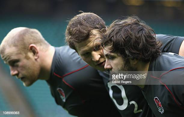 Alex Corbisiero who will replace the injured Andrew Sheridanpacks down with Dylan Hartley and Dan Cole during the England training session held at...