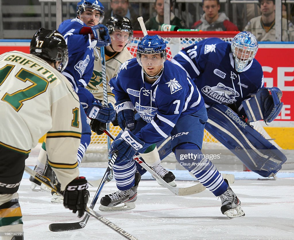 Alex Cord #7 of the Mississauga Steelheads defends in an OHL game against the London Knights on December 9, 2012 at the Budweiser Gardens in London, Ontario, Canada. The Knights defeated the Steelheads 5-2 and tied their franchise record of 18 straight wins.