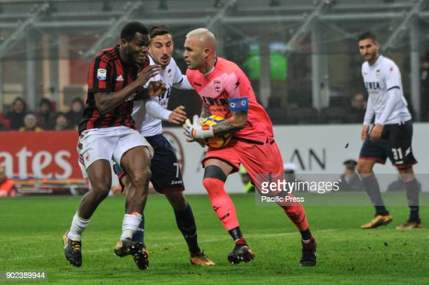 Alex Cordaz of FC Crotone competes for the ball with Frank Kessie of AC Milan during Serie A football AC Milan versus Crotone AC Milan wins the match...