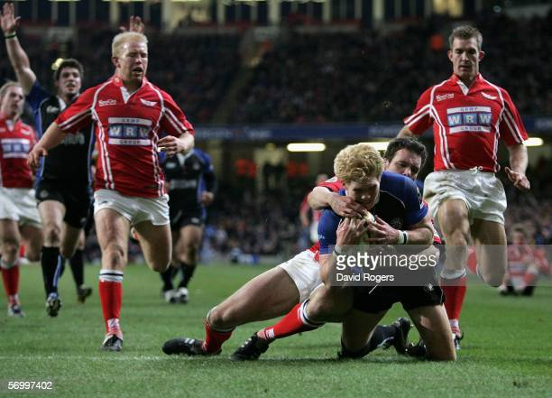 Alex Crockett of Bath goes over to score the opening try during the Powergen Cup Semi Final match between Bath and Llanelli Scarlets at the...