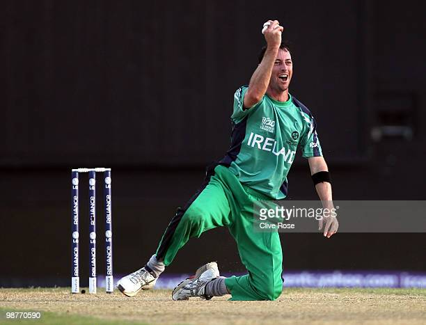 Alex Cusack of Ireland catches Dwayne Bravo of the West Indies off his own bowling during the ICC T20 World Cup Group D match between West Indies and...