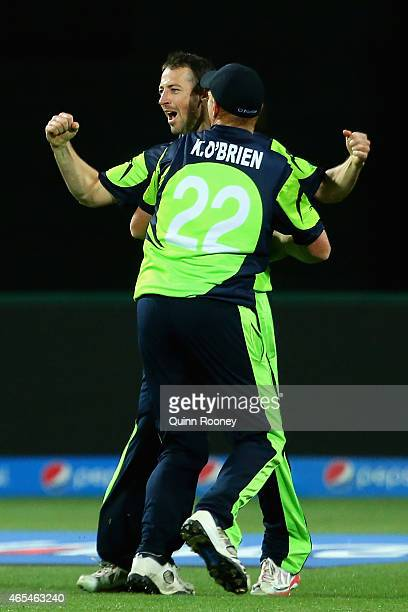 Alex Cusack of Ireland celebrates getting the wicket of Tawanda Mupariwa of Zimbabwe to win the 2015 ICC Cricket World Cup match between Zimbabwe and...