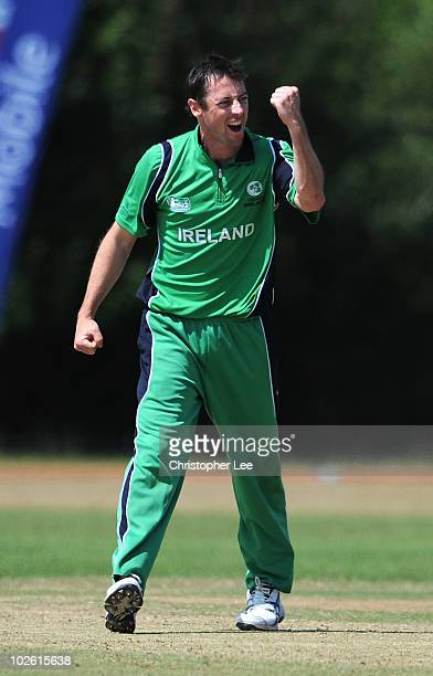 Alex Cusack of Ireland celebrates taking the wicket of Asgher Salamkhail of Afghanistan during the ICC World Cricket League Division One match...
