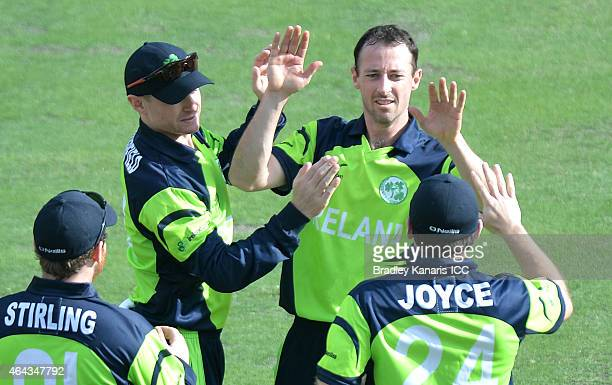 Alex Cusack of Ireland celebrates with team his mates after taking the wicket of Rohan Mustafa of the United Arab Emirates during the 2015 ICC...