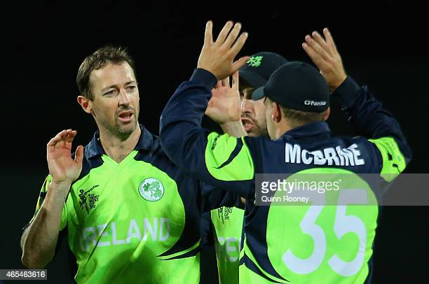Alex Cusack of Ireland is congratulated by team mates after getting the wicket of Regis Chakabva of Zimbabwe during the 2015 ICC Cricket World Cup...