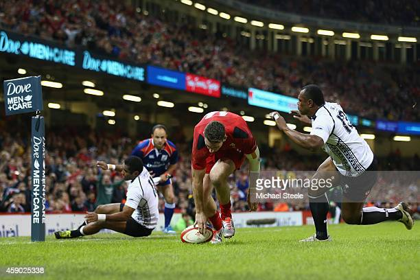 Alex Cuthbert of beats Asaeli Tikoirotuma and Vereniki Goneva of Fiji to score his sides second try during the International match between Wales and...
