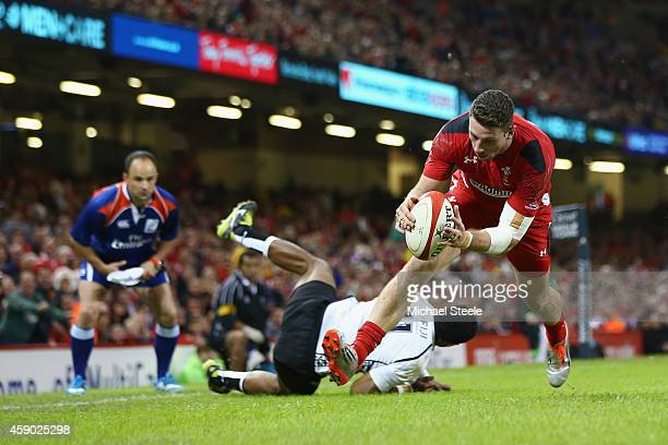 Alex Cuthbert of beats Asaeli Tikoirotuma of Fiji to score his sides second try during the International match between Wales and Fiji at the...