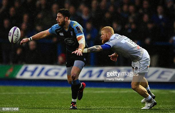 Alex Cuthbert of Cardiff Blues is tackled by Tom Homer of Bath Rugby during the European Rugby Challenge Cup match between Cardiff Blues and Bath...
