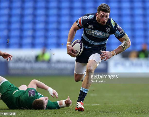 Alex Cuthbert of Cardiff breaks clear from the tackle of Eoin Griffin of London Irish during the European Rugby Challenge Cup match between London...