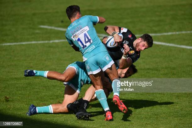 Alex Cuthbert of Exeter Chiefs is tackled by Ashley Beck and Nick David of Worcester Warriors during the Gallagher Premiership Rugby match between...