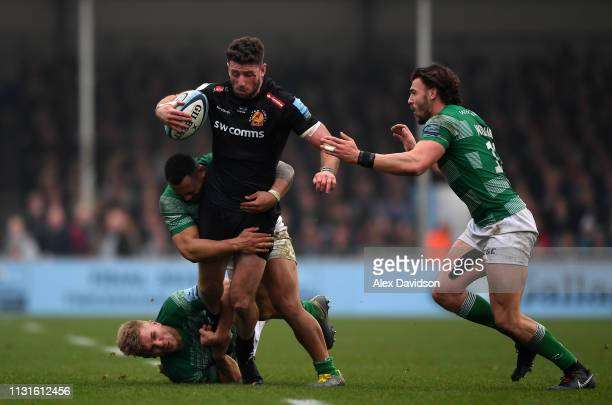 Alex Cuthbert of Exeter Chiefs is tackled by Chris Harris, Johnny Williams and Sinoti Sinoti of Newcastle Falcons during the Gallagher Premiership...