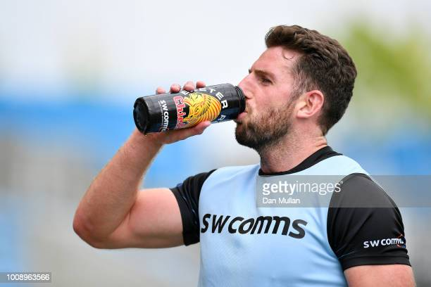 Alex Cuthbert of Exeter Chiefs takes a drink during a training session at Sandy Park on August 1 2018 in Exeter England
