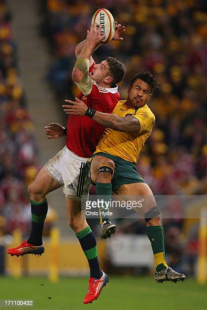 Alex Cuthbert of the British & Irish Lions catches the ball whilst tackled by Digby Ioane of the Wallabies during the First Test match between the...