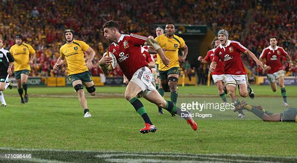 Alex Cuthbert of the Lions breaks clear to score the Lions second try during the First Test match between the Australian Wallabies and the British &...