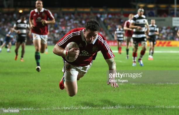 Alex Cuthbert of the Lions scores his first try during the match between the British Irish Lions and the Barbarians at Hong Kong Stadium on June 1...