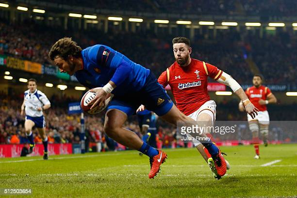 Alex Cuthbert of Wales bears down on Maxime Medard of France during the RBS Six Nations match between Wales and France at the Principality Stadium on...