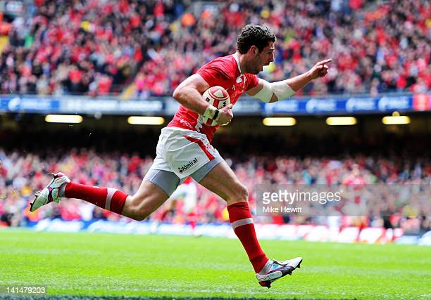 Alex Cuthbert of Wales celebrates as he runs in the opening try during the RBS Six Nations Championship match between Wales and France at the...