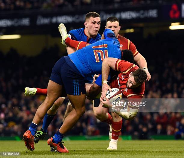 Alex Cuthbert of Wales is tip tackled by Jonathan Danty of France during the RBS Six Nations match between Wales and France at the Principality...