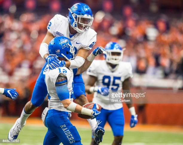 Alex Dale of the Middle Tennessee Blue Raiders congratulates Reed Blankenship for his fourth quarter interception against the Syracuse Orange on...