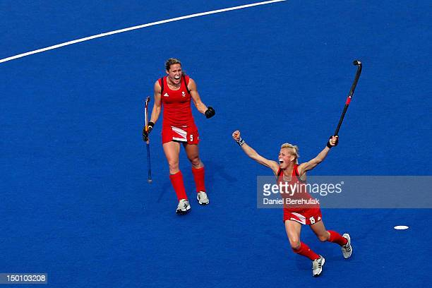Alex Danson and Crista Cullen of Great Britain react during the first half against New Zealand during the Women's Hockey bronze medal match on Day 14...