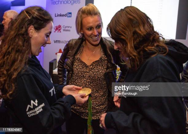 Alex Danson MBE showing her Olympic Gold Medal to athletes at the Dell Technologies Challenge on September 25 2019 in Cardiff Wales