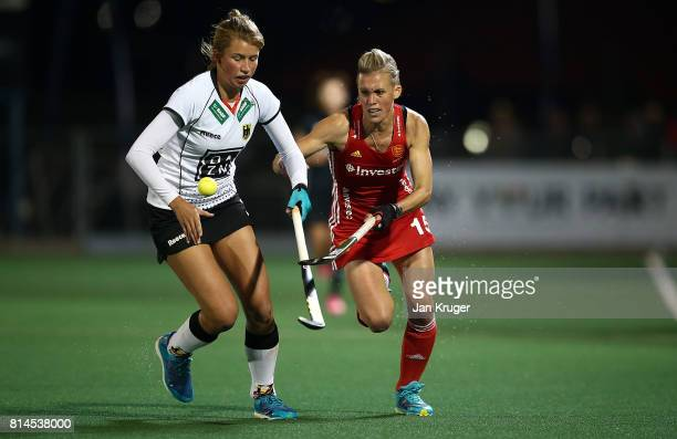 Alex Danson of England battles with Hanna Granitzki of Germany during day 4 of the FIH Hockey World League Women's Semi Finals Pool A match between...