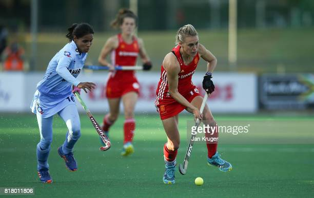 Alex Danson of England battles with Vandana Katariya of India during day 6 of the FIH Hockey World League Women's Semi Finals quarter final match...