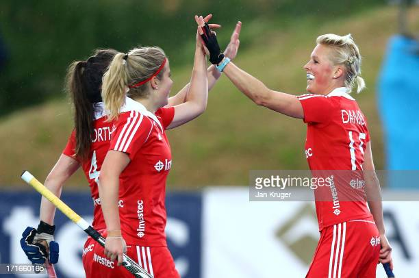 Alex Danson of England celebrates her goal with team mates during the Investec Hockey World League quarterfinal match between England and Italy at...