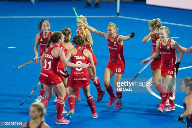 Alex Danson of England celebrates scoring the opening goal with team mates during the Pool B game between USA and England of the FIH Womens Hockey...