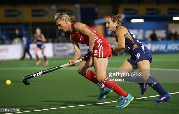 Alex Danson of England controls the ball from Alyssa Manley of United States of America during day 7 of the FIH Hockey World League Women's Semi...
